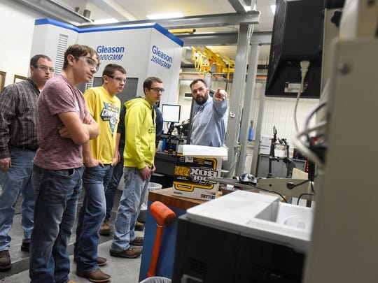 Advanced Manufacturing Engineer Andy Binsfeld explains functions in the quality control area during a tour of the Columbia Gear facility Thursday, Dec. 14, in Avon.
