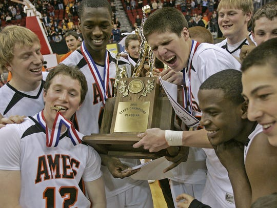 PFILE -- Ames players celebrated with trophy after
