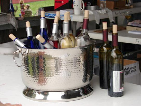 Bottles of wine wait to be used at the Wine Tasting