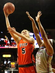 UTEP's Zuzanna Puc, 5, takes a one-handed shot over Alexus Malone of Louisiana Tech on Saturday in the Don Haskins Center.