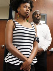 Maya Dixon, who was arrested in a clash with police last week at Fairfield Aquatic Center, was present for a news conference given Tuesday by Bishop Bobby Hilton.