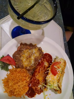 A tamale and taco combination platter with a Cadillac margarita.