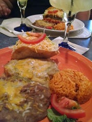 The chile relleno and chicken taco combination platter at Los Pepes.