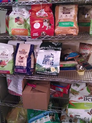 Some donations of pet food to the Safe Haven Food Pantry and Thrift Shop in Hopewell Junction.