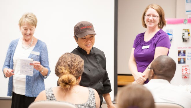 Umami Ramen owner Peecoon Allen thanks judges after being awarded second place in the pitch competition at Startup Fest in 2015. This year, the Generation E Institute is searching for a new batch of entrepreneurs to compete for cash prizes.