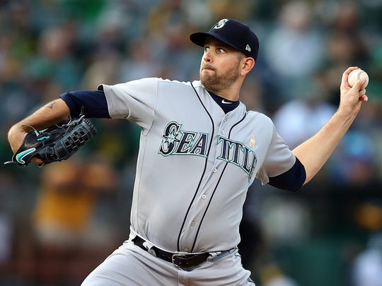 FILE - In this Saturday, Sept. 1, 201 file photo ,Seattle Mariners pitcher James Paxton works against the Oakland Athletics during the first inning of a baseball game in Oakland, Calif. A person familiar with the negotiations tells The Associated Press the New York Yankees have agreed to acquire left-hander James Paxton from the Seattle Mariners for left-hander Justus Sheffield and two other prospects, Monday, Nov. 19, 2018. (AP Photo/Ben Margot, File)
