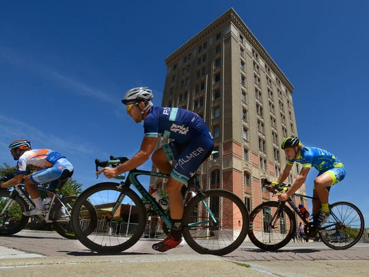 Racers make their way along Government St. during the Pro 1/2 race of the Subway Pensacola Cycling Classic in downtown Pensacola.
