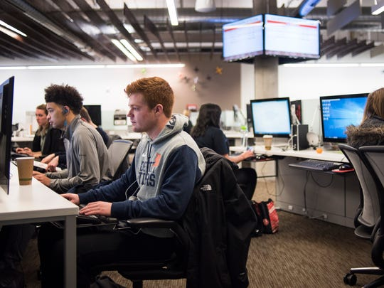 """I really value Jackson's career support and flexibility with our school schedules, MSU sophomore Thomas Washington, left, said, Wednesday March 21, 2018, at the Jackson Zone, Wednesday, March 21, 2018, in East Lansing.   Washington works about 15 hours per week as an SSA, or strategic support associate."