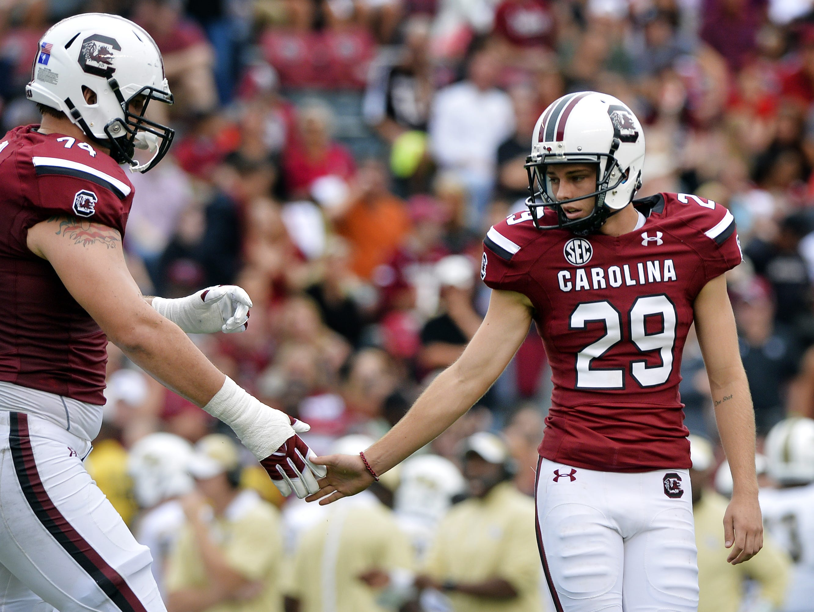 USC offensive lineman Mason Zandi, left, and kicker Elliot Fry (29), shown after a field goal in 2015, were two of the Gamecocks' participants in a pro day Tuesday.