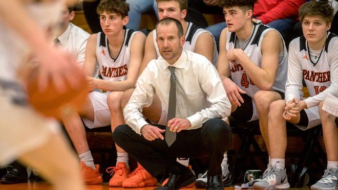 Washington boys basketball coach Eric Schermerhorn keeps an eye on the action as his team battles Limestone Thursday, Dec. 5, 2019 in Washington.