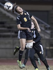 Golden West's Alexis Benavidas (8) heads the ball against Redwood in a WYL girls soccer match at Giant Chevrolet-Cadillac Mineral King Bowl on Thursday, January 5, 2017.