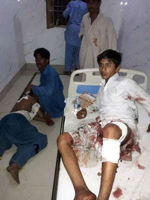 Injured Pakistani blast victims are treated at a local hospital after a bomb explosion in the shrine of 13th century Muslim Sufi saint Lal Shahbaz Qalandar in the town of Sehwan in Sindh province, on Feb. 16, 2017.   A bomb ripped through a crowded Sufi shrine in Pakistan on February 16, killing up to 35 people and wounding 60, officials said, the deadliest in a series of attacks to strike the insurgency-wracked country this week. A bomb ripped through a crowded Sufi shrine in Pakistan February 16, killing up to 35 people and wounding 60, officials said, the deadliest in a series of attacks to strike the insurgency-wracked country this week. / AFP PHOTO / STRSTR/AFP/Getty Images ORIG FILE ID: AFP_LR5KU