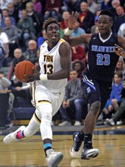 Toms River North's Jaden Rhoden drives against Shawnee's Daevon Robinson in the Group IV South Jersey State Championship at Toms River North High School March 7, 2017.