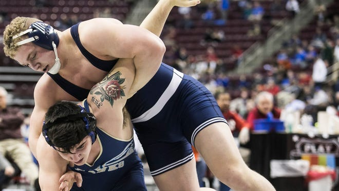 Dallastown's Bryce Shields, right, has won three consecutive PIAA Class 3-A state bouts at 220 pounds after dropping his opener to assure himself of a medal. Amanda J. Cain photo