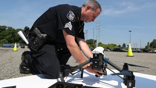 Clarkstown Police Department Sgt. Kevin Quinn prepares a drone for flight during a demonstration in a parking lot at the Palisades Center mall in West Nyack June 13, 2017.