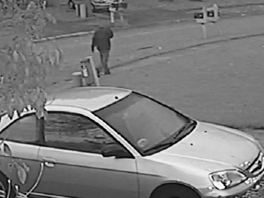 One of two surveillance photos of suspect in Amanda