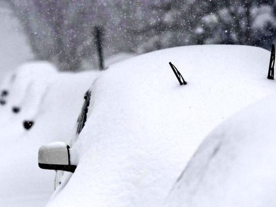 Snow covers cars during a major snow storm on Saturday,