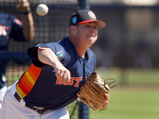 Houston Astros pitcher Brad Peacock throws live batting practice during spring training baseball practice Monday, Feb. 19, 2018, in West Palm Beach, Fla. (AP Photo/Jeff Roberson)