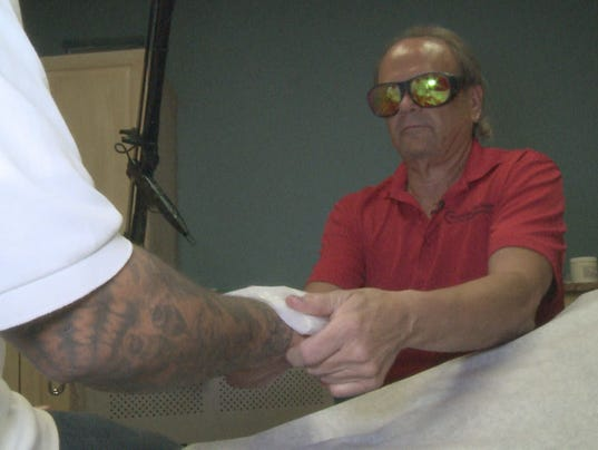 Tattoo removal helps gang members turn life around for Tattoo removal des moines