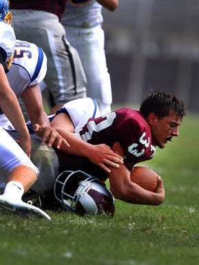 Michael DeSantis is tackled during a game against Spotswood last season.