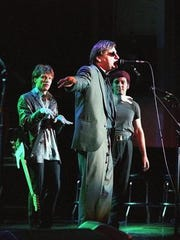 Southside Johnny Lyon sings while Jon Bon Jovi and Bruce Springsteen look on in this classic shot from the Come Together concert at the Count Basie Theatre, Jan. 31, 1998