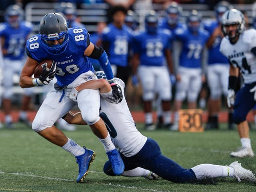 Utica Eisenhower's Henry Janeway is tackled by Macomb