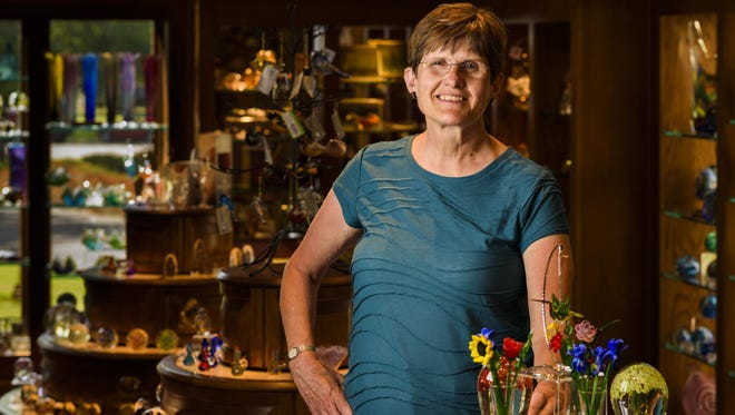 """Liane Butitta has been volunteering at the Bergstrom-Mahler Museum of Glass in Neenah for 35 years. """"It's truly a treasure for the community,"""" she said. """"People are wowed with what we have."""""""
