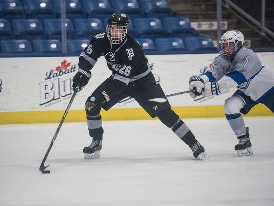 Plymouth's Jack VanDenBeurgeury (26) skates toward