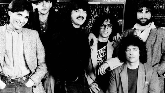 Dominate record award nominations - The rock group Toto, shown with members, from left: Mike Porcaro, Jeff Porcaro, Bobby Kimball, Steve Porcaro, Steve Lukather and David Paich, led the pack in Los Angeles, Tuesday, Jan. 11, 1983 in nominations for the 25th annual Grammy Awards, gathering nine nominations, including those for song and record of the year. (AP Photo)