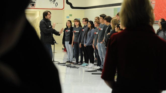 "Lauren Roberts/Times Record News The Wichita Falls High's choir sings at ""Culture Shock"" on Tuesday at Wichita Falls High School. ""Culture Shock"" is Old High's fine arts night on which the theater students, orchestra, choir and band perform along with a painting demonstration."