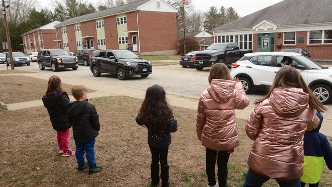 Putnam teachers parade through town in March to see their students.