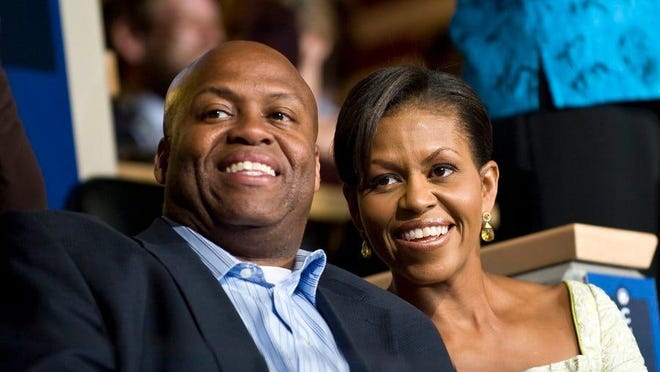 Craig Robinson with his sister, former First Lady Michelle Obama.