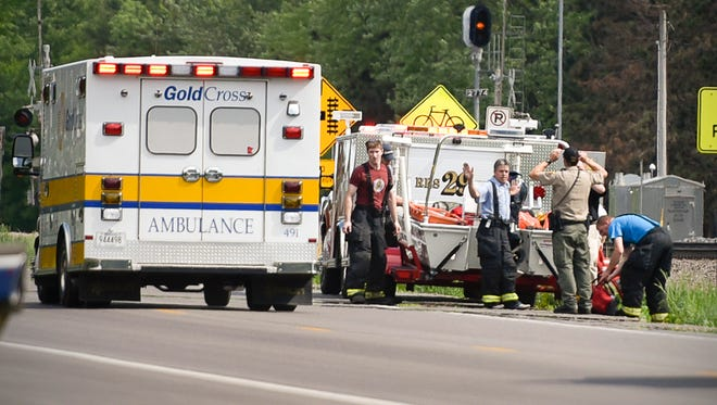 A Gold Cross Ambulance takes a woman to the St. Cloud Hospital after rescuers pulled her from the Mississippi River Thursday, May 26, near Sartell.