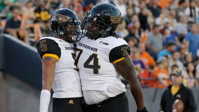 Southern Miss offensive lineman Jerry Harris, right, comes into spring camp this season as the team's starting left tackle.