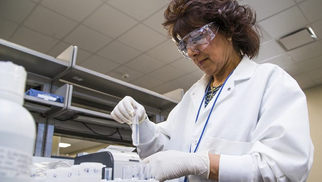 Chemist Mona Kamel tests water at the Tempe Water Quality Lab-South on April 22, 2016.