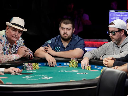 John Hesp, of Britain; Morristown native Scott Blumstein; and Antoine Saout, of France, from left, compete during the main event of the World Series of Poker, Thursday, July 20, 2017, in Las Vegas.