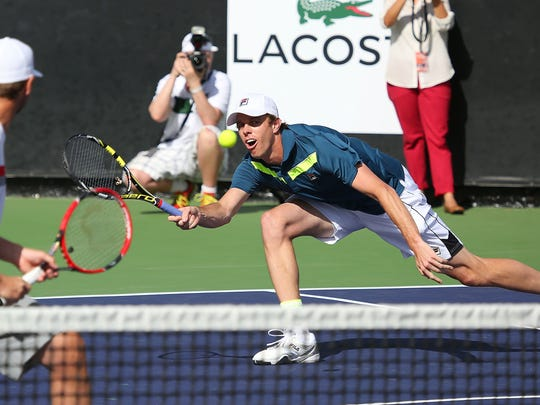 Sam Querrey and Mardy Fish play doubles at the Desert Smash charity tennis event at the La Quinta Resort, Tuesday, March 10, 2015.
