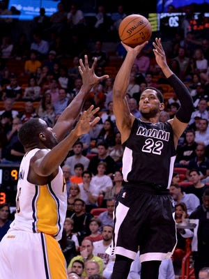 Jan 23, 2015: Miami Heat forward Danny Granger (22) shoots over Indiana Pacers center Ian Mahinmi (28) during the first half at American Airlines Arena.