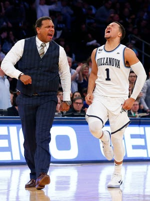 Villanova Wildcats guard Jalen Brunson (1) reacts  in front of Providence Friars head coach Ed Cooley after making a three point shot during the second half of the Big East Conference Tournament Championship at Madison Square Garden.