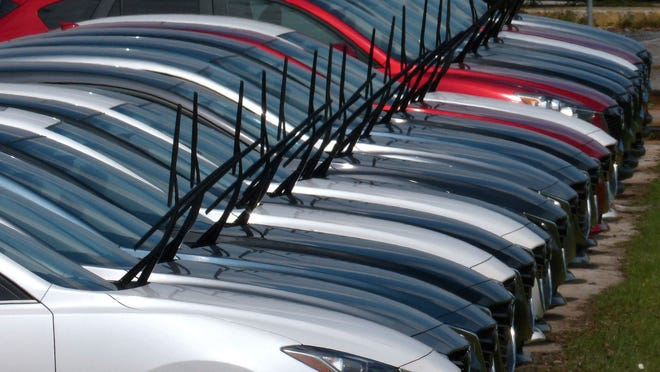 Raised windshield wipers on cars at Sandy Sansing Mazda indicate that the cars have been flagged as flood damaged and will not be able to be sold to the public.