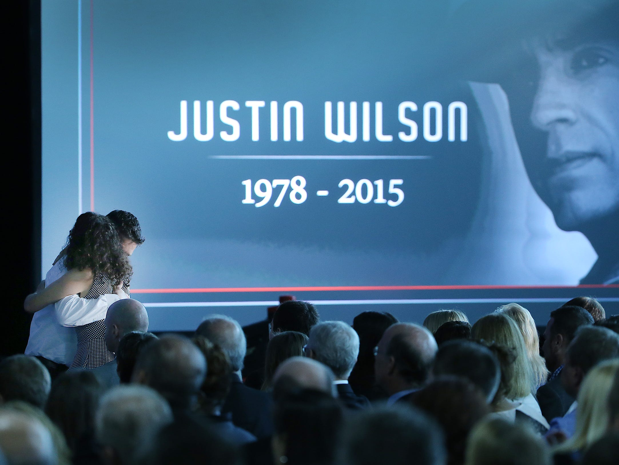 """The Indianapolis Motor Speedway hosted """"Celebrating the Life of Justin Wilson"""" Tuesday, Sept. 29, 2015 afternoon at the IMS pavilion. Here Chris Mower hugs Julia Wilson, Justin's widow, during the memorial."""