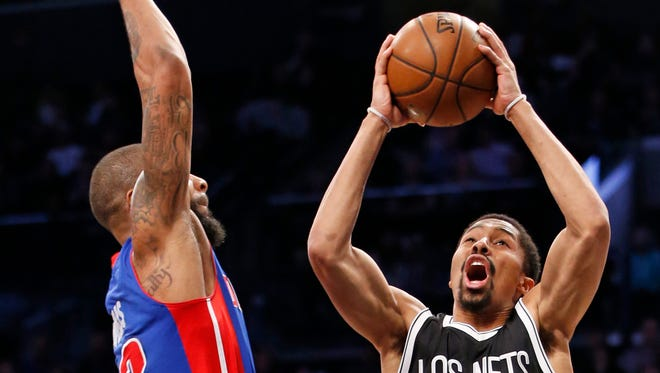 Nets guard Spencer Dinwiddie (8) reacts as Pistons forward Marcus Morris (13) fouls him during the second half of the Pistons' 98-96 loss Tuesday in Brooklyn, N.Y.