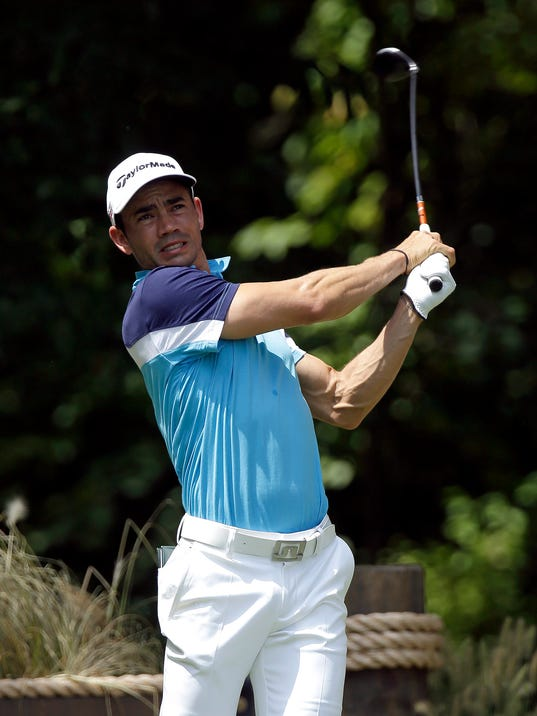Camilo Villegas, of Colombia, hits from the first tee during the final round of the Wyndham Championship golf tournament in Greensboro, N.C., Sunday, Aug. 17, 2014. (AP Photo/Gerry Broome)