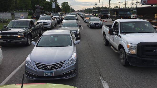 Carb Day traffic is stopped on 16th Street near Gate 1 of the Indianapolis Motor Speedway on Friday.
