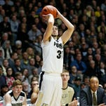 Dakota Mathias drains a three-point shot in front of the Purdue bench in the second half against Michigan Thursday, January 7, 2016, at Mackey Arena. Purdue defeated Michigan 87-70.