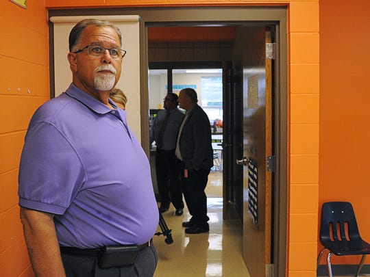 Kent Alberty, Sioux Falls School Board president, takes a look inside a kindergarten classroom during a tour of Sioux Falls School District building projects Wednesday, Sept. 2, 2015, at Susan B. Anthony Elementary School in Sioux Falls.