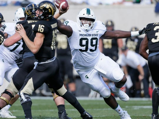 Defensive tackle Raequan Williams and the rest of the Spartans' defensive front pestered WMU QB Jon Wassink and slowed the Broncos' running game.