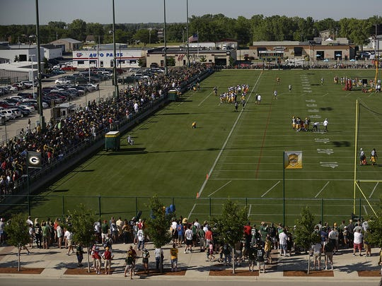 Fans watch the Green Bay Packers during training camp practice at Ray Nitschke Field on Thursday.