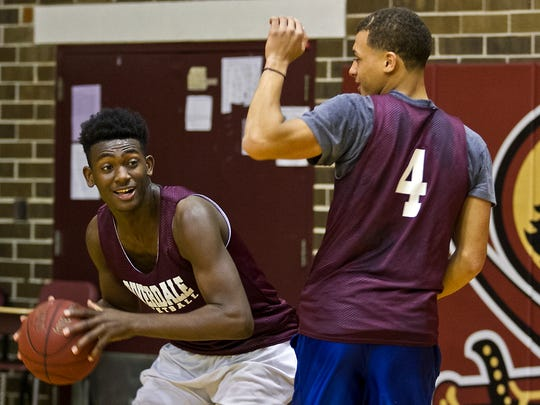 From left, Riverdale High School's Jaquez Dickerson is guarded by teammate Jacob Tracey during a brief one on one match up at practice Tuesday afternoon (02/10/16).