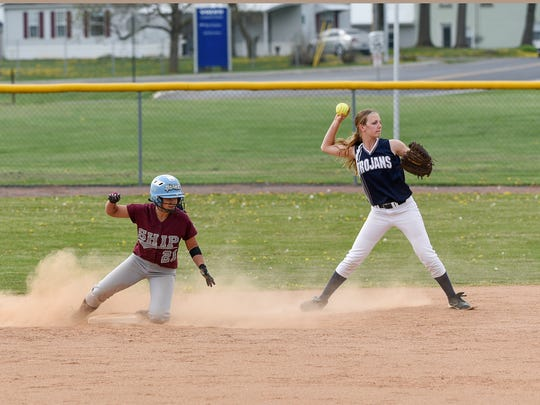 Shippensburg's Ashley Macedo slides into second but is tagged out by Chambersburg's Alexis Estep during a softball game on Friday, April 22, 2016 in Shippensburg, Pa. Chambersburg defeated Shippensburg 8-1.
